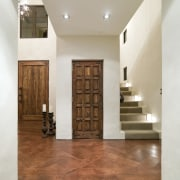 A view of a home designed by Masonry ceiling, estate, floor, flooring, hardwood, interior design, laminate flooring, lobby, property, stairs, tile, wall, wood, wood flooring, gray, brown