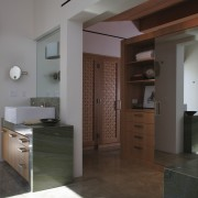 The bathroom, wardrobe and bedroom all form one cabinetry, floor, interior design, kitchen, room, gray, brown