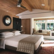 A three-quarter height dividing wall acts as a bed frame, bedroom, ceiling, interior design, real estate, room, suite, wall, brown
