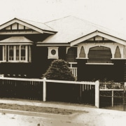 A view of the home in its original building, cottage, facade, history, home, house, property, residential area, shed, white, black