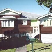 A view of the home before it was cottage, elevation, facade, home, house, neighbourhood, property, real estate, residential area, siding, suburb, black