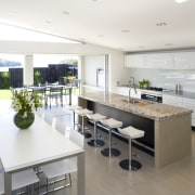 A view of the kitchen and dining areas, countertop, interior design, kitchen, real estate, white