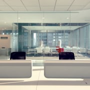 Interior view of Lloyd's Reinsurance Co. featuring stone daylighting, glass, interior design, lobby, office, gray, white