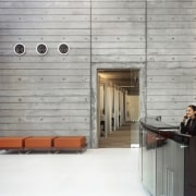 Rough-caste concrete, with pattenering to suggest the bored-formed architecture, floor, flooring, furniture, wood, gray