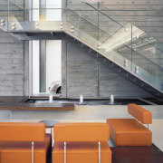 A central fountain provides white noise to mask architecture, countertop, daylighting, floor, furniture, glass, interior design, loft, product design, stairs, table, gray