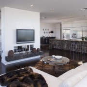 Simple, classic styling defines the apartment interiors. The interior design, living room, property, real estate, room, gray
