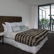 Simple, classic styling defines the apartment interiors. The bed frame, bedroom, floor, home, interior design, mattress, property, real estate, room, window, wood, gray, black