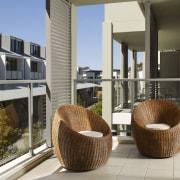 All units feature light spacious interiors, and balcoies. architecture, condominium, furniture, outdoor furniture, real estate, gray, black