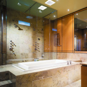 A view of this bathroom that feature the bathroom, ceiling, countertop, floor, interior design, room, tile, brown