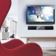 A view a home theatre system from Phillips display device, flat panel display, furniture, interior design, living room, media, multimedia, product design, room, table, television, white, red