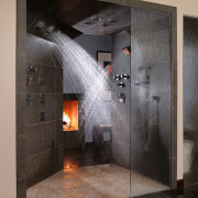 A view of these showers that feature the bathroom, fireplace, floor, flooring, hearth, interior design, black, gray
