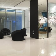Pale hues for the walls are carried throughout ceiling, floor, flooring, glass, interior design, lobby, product design, gray