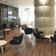 A predominantly brown and taupe colour palette is ceiling, chair, conference hall, floor, flooring, furniture, hardwood, interior design, lobby, table, waiting room, wood, wood flooring, brown