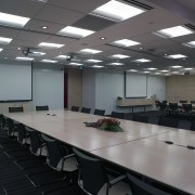 A view of the UBS offices, meetin rooms auditorium, ceiling, classroom, conference hall, interior design, office, table, gray, black
