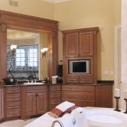 A view of this octagon shaped bathroom designed cabinetry, countertop, cuisine classique, floor, furniture, home, interior design, kitchen, real estate, room, window, brown, orange