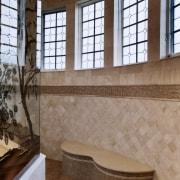 A view of this octagon shaped bathroom designed bathroom, estate, floor, flooring, interior design, property, room, tile, wall, window, brown