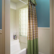 A view of this childrens bathrom designed by bathroom, curtain, floor, home, interior design, room, textile, window, window covering, window treatment, gray