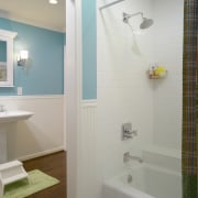 A view of this childrens bathrom designed by bathroom, bathroom accessory, ceiling, daylighting, floor, home, interior design, plumbing fixture, property, room, sink, tile, wall, window, gray