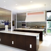 View of the kitchen, wooden cabinetry, stainless steel countertop, interior design, kitchen, white