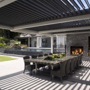 A view of the outdoor living area. - outdoor structure, patio, black