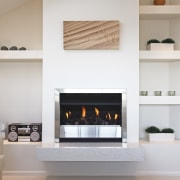 A view of a fireplace from Real Fires. fireplace, hearth, home appliance, living room, wood burning stove, gray, white
