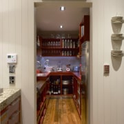 View of the pantry with hardwood countertops, sinks cabinetry, countertop, floor, flooring, hardwood, interior design, kitchen, room, wood, gray, brown