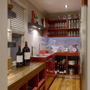 View of the pantry with hardwood countertops, sinks cabinetry, countertop, interior design, kitchen, liquor store, room, brown