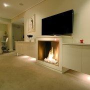 A view of a fireplace from Real Fires. fireplace, floor, flooring, hearth, home, interior design, living room, real estate, room, brown, orange