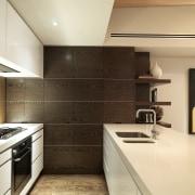 View of kitchen designed by Nicholas Murray featuring cabinetry, countertop, cuisine classique, floor, flooring, interior design, kitchen, room, under cabinet lighting, orange, brown