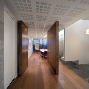 The cubic pattern on the fabric panels in ceiling, floor, flooring, interior design, real estate, wood flooring, gray