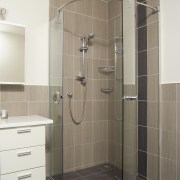 A view of some bathroomware from Kohler. - angle, bathroom, floor, glass, plumbing fixture, shower, shower door, tile, gray
