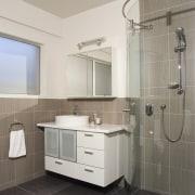 A view of some bathroomware from Kohler. - bathroom, bathroom accessory, bathroom cabinet, floor, home, interior design, plumbing fixture, room, sink, gray