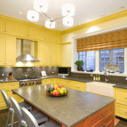 view of kitchen featuring lighting, yellow cabinetry, countertops, ceiling, countertop, estate, home, interior design, kitchen, real estate, room, window, yellow, orange