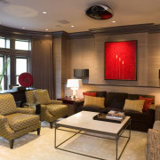 view of media room featuring brown grasscloth covering ceiling, interior design, living room, lobby, room, brown