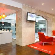 To provide varying light levels, the designer used ceiling, flooring, interior design, lobby, real estate, orange