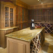 View of countertop by A Touch Of Stone. cabinetry, countertop, flooring, hardwood, interior design, kitchen, room, wine cellar, winery, wood, brown, orange