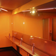 Resene paints aslo feature on the interior, the architecture, ceiling, flooring, interior design, light, light fixture, lighting, orange, room, table, wall, red