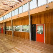 View of Williamstown High School in Melbourne. Designed architecture, ceiling, daylighting, floor, flooring, hardwood, wood, orange, brown
