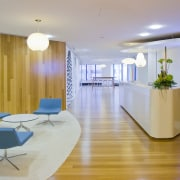 View of the Kiwi Income Property Managment offices apartment, architecture, ceiling, conference hall, daylighting, floor, furniture, interior design, lobby, office, real estate, table, waiting room, gray