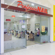 View of retail shop entrance of Professional Nail, outlet store, product, retail, shopping mall, white, gray