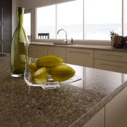 Other silestone surfaces include, Koan and Gedastu from countertop, floor, flooring, interior design, kitchen, table, tile, yellow, brown, white