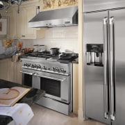 The Jenn-Air Pro-Style Stainless suite of appliances  cabinetry, countertop, gas stove, home appliance, interior design, kitchen, kitchen appliance, kitchen stove, major appliance, refrigerator, room, gray