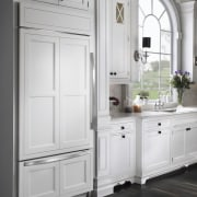 Sub-Zero's integrated refrigerator and freezer merges with the bathroom accessory, cabinetry, chest of drawers, countertop, cuisine classique, cupboard, furniture, home appliance, kitchen, kitchen appliance, major appliance, refrigerator, room, gray, white