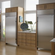 This kitchen features a Wolf Single Oven, a cabinetry, countertop, home appliance, interior design, kitchen, kitchen appliance, major appliance, product, refrigerator, room, brown, gray