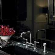 The Kohler Torq faucet features a high-curved, bridged darkness, glass, interior design, room, table, black