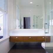 View of bathroom featuring teak-fronted drawers and basalt architecture, bathroom, daylighting, floor, home, interior design, room, sink, gray