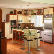 View of kitchen designs recommended by NKBA to cabinetry, countertop, cuisine classique, floor, flooring, hardwood, interior design, kitchen, real estate, room, wood flooring, brown, orange