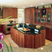 view of kitchen by Dream Kitchens, featuring cabinetry, cabinetry, countertop, cuisine classique, interior design, kitchen, room, orange