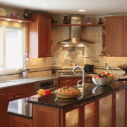 view of kitchen by Dream Kitchens, featuring cabinetry, cabinetry, countertop, cuisine classique, flooring, interior design, kitchen, room, brown