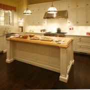 View of the white kitchen, cabintery with matte cabinetry, countertop, cuisine classique, floor, flooring, hardwood, kitchen, room, wood, wood flooring, brown